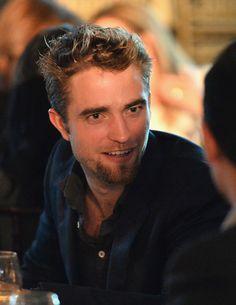 Robert Pattinson sat in some flattering lighting. | 21 Things Celebrities Did This Week