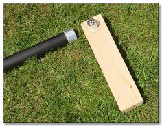 A simple socket mounted to a block of wood to put your foot on to rotate setup