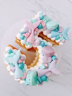 Planning a themed mermaid birthday party and don't know what to serve? Inspire yourself with these 19 mermaid birthday party food ideas kids will love! Number Birthday Cakes, Mermaid Birthday Cakes, Barbie Birthday Party, Number Cakes, 5th Birthday, Birthday Ideas, Mermaid Cookies, Mermaid Cupcakes, Sirenita Cake