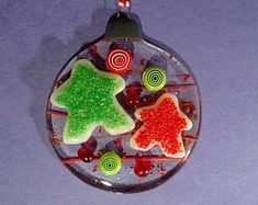 Unique glass art by LeavesOfGlassArt on Etsy Fused Glass Ornament: Cast Meeples, topped with frit and tack-fused to a round base ornament Fused Glass Ornaments, Stained Glass Art, Tack, Art Projects, Christmas Bulbs, Etsy Seller, Leaves, Create, Holiday Decor