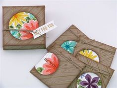noetecard set:  3 X 3 cards and a  package by Martha Inchley ... luv the look of Hardwood wookgrain on the diagonal ... kraft base ... brightly colored flowers on a popped up die cut circle ... great gift idea ... Stampin'Up!