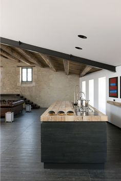 Living space- white ceiling, Dark floor, blonde & mid wood, copper, blue & green ceramic & glass