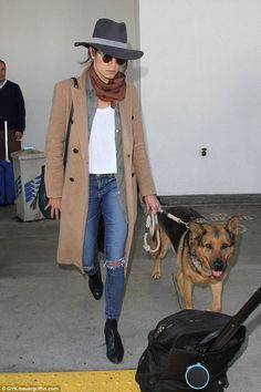 Canine companion: Nikki was flanked by the couple's beloved dog as she made a speedy exit...