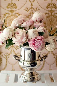 peony arrangement in a silver Champagne bucket