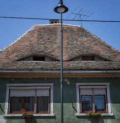 The Romania eyes: eyelid windows in the rooftops of Sibiu and other Romanian cities give the impression that someone always has their eye on you. Romania, Rooftop, Gazebo, Outdoor Structures, City, Building, Creepy, Travel, Eyes