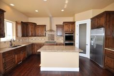 Kitchen with island and cream counters