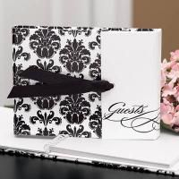 White, gatefold guest book with black damask design and black grosgrain ribbon closure. 7 x 5 and records 800 signatures. Wedding Guest Book, Wedding Reception, Wedding Venues, Formal Wedding, Black And White Wedding Theme, Wedding Supplies Wholesale, Black Wedding Invitations, Wedding Stationary, Invites