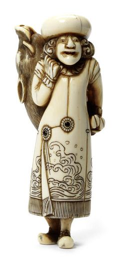 A fine and rare ivory netsuke of a Dutchman, Kyoto, late 18th century Standing, his body twisted slightly to the left as he holds a captured wild boar on his back, he wears a long coat divided asymmetrically, engraved with a design of breaking waves and fastened with two inlaid buttons, a broad-rimmed hat and buckled shoes, the slightly-worn ivory bears a fine patina and the eye pupils are inlaid, unsigned. 9.5cm (3¾in).