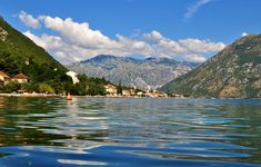Photo about Photo of Kotor bay with cristal water and a blue sky - Kotor Bay - Montenegro - July 2010. Image of july, montenegro, cristal - 113952013