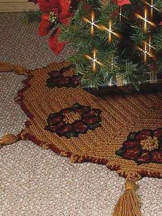 """Dress up your tree with an eye-catching Crochet 'n Weave tree skirt. Size: Grid is 9 1/2"""" x 20 1/2"""" before weaving. Finished Tree Skirt: 54"""" across, not including Tassels.Skill Level: Intermediate"""