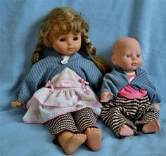 Emma's dolls dressed in tops and pants made from old sweaters