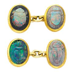 A pair of antique opal cufflinks, each link set with a carved black opal scarab within a chased bezel setting, chain connections, circa 1890
