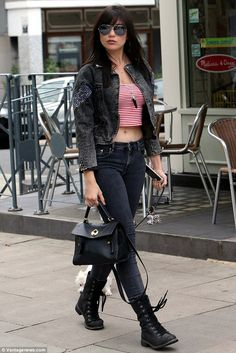 Work it: Daisy Lowe ensured all eyes were on her as she showcased her toned curves while walking her pet pooch in north London on Wednesday