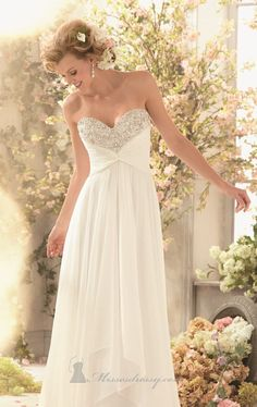 You'll be the perfect bride in Voyage by Mori Lee 6773. This flowing wedding gown is made of delicate chiffon. The strapless bodice features a sweetheart neckline with an open back. Sparkling crystal beading adorn the bodice while the skirt extends to a train.
