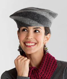 Flat Top Beret by Miriam Carter. With a playful two-tone spiral, this charming hat is a contemporary take on the classic beret. The artist, a fourth-generation felt-maker, uses a traditional wet-felting process to transform merino wool fiber into a dense yet lightweight fabric, which she then shapes on a handmade hat mold into a fun and cozy three-season accessory.