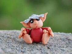 Hello, Im Russuhl, a little Troll Elf of the mushrooms.    I live in the woods and I like to sit under the shadow of the underbrush mushrooms,