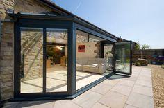 A Guide to Bi-Folding Doors Side Extension, Folding Doors, Patio Doors, Back Gardens, Window Treatments, Building A House, Blinds, Beach House, Windows