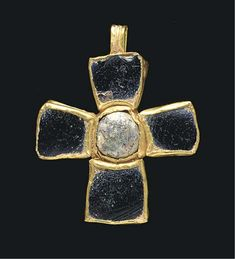 A BYZANTINE GOLD AND GLASS PENDANT CROSS CIRCA 6TH-7TH CENTURY A.D. One side set with an aubergine glass inlay in each arm and a circular glass cabochon in the center, the other side with a raised foliate pattern branching from the center, a ribbed suspension loop above
