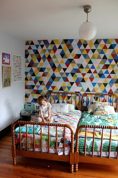 Home owner Meghan Mcewen had been obsessing over French wallpaper that was out of her budget so she decided to get the same look with paint. She cut a cardboard triangle, traced it over and over onto the wall, and then painted each square.