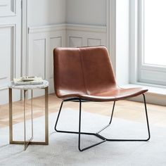 Slope Leather Lounge Chair It's light, it's easy to move it takes up a relatively small floor footprint. This is perfect for a lounge chair that isn't an arm chair. Also love a bit of tan leather it's durable and adds a bit of contrast