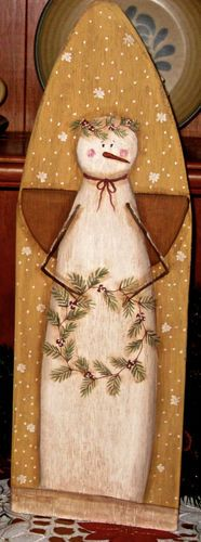 Antique Ironing Board w/painted snowman. I think I would try a black chalk background.
