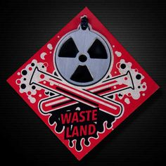 """WASTELAND KEYCHAIN BY CRRANKY It's time to get nuclear. Ya know, good for making heat, electricity and those awesome mushroom clouds.  The Wasteland Keychain is a part of the Apocalypse Series.  Includes thick-heavy 13 gauge, 1.5"""" diameter, stainless steel Wasteland medallion, 2 color hand screen printed chipboard package and 6 inch steel cable keychain.  Crafted with attitude in Kansas, USA.  http://crranky.com"""