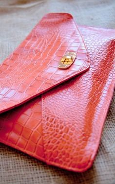 Coral envelope clutch...