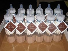hot chocolate mix in baby bottles as favors - this works well for a winter baby shower !!
