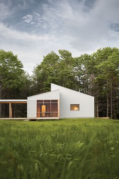 "Although the house is modern, the shed roofs reference Maine vernacular forms. The Walshes opted out of foundation plantings in order to create the crisp look of a house in a meadow. ""The feel of the house is very clean … Continue reading →"