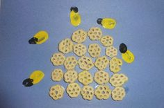 Using honeycomb cereal make a beehive, add fingerprint bees, add stripes and background when done.