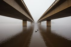 2011 Canberra Bridge in fog by longreach, via Flickr