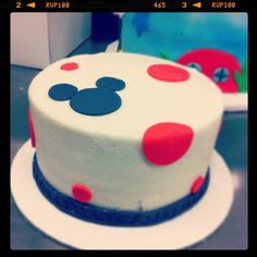 Mickey baby smash cake.  Vanilla cake and buttercream with fondant dots and Mickey silhouette.