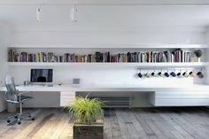 http://dailydwell.com/wp-content/uploads/2015/03/modern-work-area-desk-bookshelf-900x600.jpg