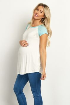 Complete your basics this season with this chic colorblock maternity top. Short sleeves will keep you cool while the soft fabric accommodates your growing belly. Simply style this top with maternity jeans and flats for a complete look.