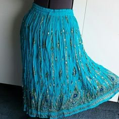 Plus 3XL MAXI SKIRT Turquoise  with blue  green and gold painted on print paisley border  rayon elastic waistband with drawstring for adjustment . Length is 35 in Skirts Maxi