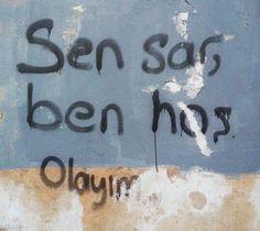 Sen sar ben hoş olayım duvar yazsısı şiir sokakta