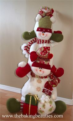 I love plush snowmen...I have several snowmen families for my Christmas decor!