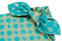 Wrapping a book with Furoshiki...the furoshiki can be reuse...very eco way to wrap a gift ^0^