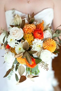 Hello Darling featured on @brides  : Fall #bridalbouquet of ranunculus, dahlias, roses, celosia, seeded eucalyptus, and ruscus. Photo by Miller + Miller Photography #hellodarling