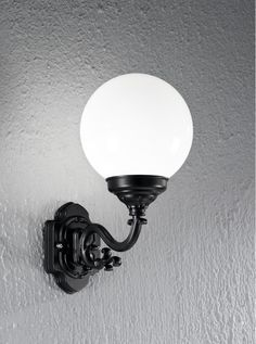EXT6590 Rotondo Italian wall light small, black aluminium. Italian die-cast aluminium matt black exterior fitting with opal polycarbonate spheres. outdoor IP43 Rated 1 x 60w E27 Lamp not included Height- 38.5cm Width- 20cm Projection- 31.5cm BRAND- Franklite REFERENCE- EXT6590 AVAILABILITY: 3-4 Working Days