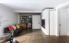 A nice micro apartment inside view of a living room, office, and library in Gramercy Park.