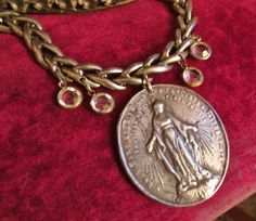 A recast I created from an original antique French religious medal in my collection. I can create one for you! Go to www.etsy.com/shop/madonnaenchanted