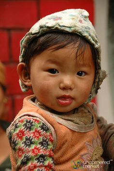 An adorable little one. Taken near Jagat along the Annapurna Circuit trek in Nepal. Annapurna is a section of the Himalayas in north-central Nepal. (V)