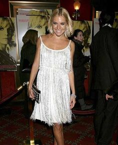 Fit for the Charleston: Sienna Miller teams a Twenties-style beaded flapper dress with gold dancing shoes