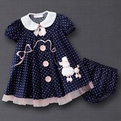 I don't even know what size it comes in, all I know is it is so cute and Audrey would look like a doll in it!  blue and pink dot poodle