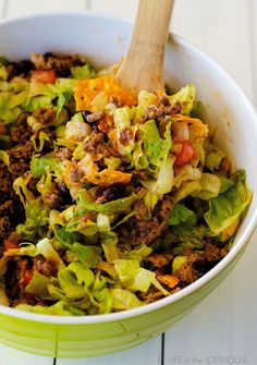 This Doritos Taco Salad is loaded with seasoned ground beef, black beans and more. What makes this salad so delicious is the nacho cheese Doritos! Mexican Food Recipes, Beef Recipes, Salad Recipes, Dinner Recipes, Cooking Recipes, Healthy Recipes, Ethnic Recipes, Yummy Recipes, Cooking Tips