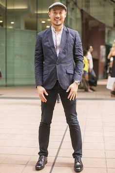 Orchard Road, SINGAPORE. Aaron Wong, company director. Armani jacket, tailored shirt from Hong Kong, tailored pants from Germany, Rolex watch, Boycott cap, Dolce & Gabbana belt, Rockport shoes. Photo Louis Kwok