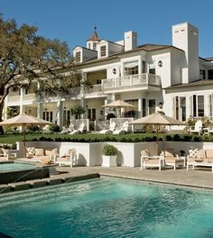 This celebrity 20-room main residence is located on four landscaped acres with a pool that complements the house and property to perfection. Click to find out who owns it!