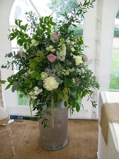 Country style milk churn flowers