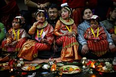 Kathmandu, Nepal: Newar girls look on as rituals are performed during an Ihi ceremony